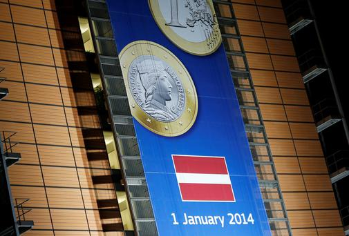 IN THE ZONE: A banner showing a Latvian euro coin at the European Commission headquarters in Brussels. The country will join the eurozone on January 1, and the currency union will then have a total number of 18 members. Photo: Francois Lenoir