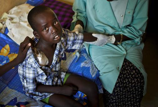 Atem Apieth, 6, who received a gunshot wound to his shoulder during the recent fighting