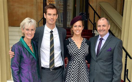 Wimbledon champion Andy Murray, with his parents Judy and Will pose with his long time girlfriend Kim Sears ahead of receiving his OBE