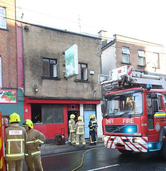 A fireman rescued a single woman from this former pub ion Broad street in Limerick on Saturday morning