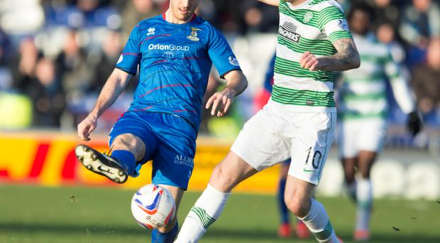 Celtic's Anthony Stokes (right) and Inverness' Ross Draper (left) in action