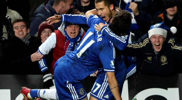 Chelsea's Eden Hazard (R) celebrates with team mate Oscar after scoring a goal against Liverpool