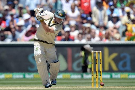 Australia's Chris Rogers hits his 100th run during day four of the Fourth Test