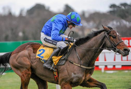 Hurricane Fly, with Ruby Walsh up, on their way to winning The Ryanair Hurdle