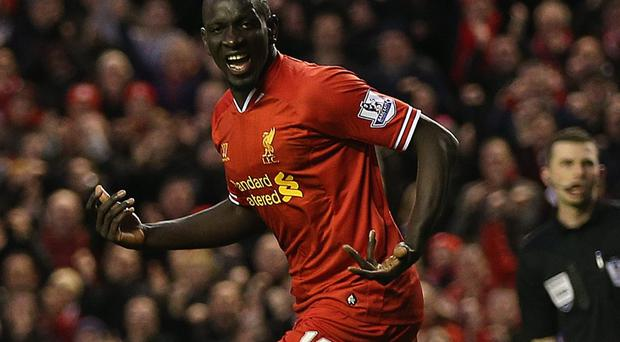 Liverpool's Mamadou Sakho has also been pictured making the gesture