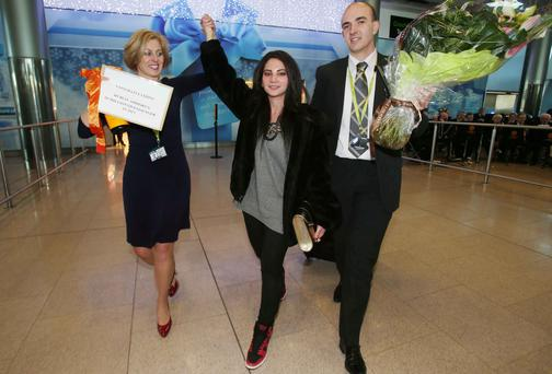 The DAA's Siobhan O'Donnell and Jamie Mills greet Roma Chang. Picture: Leon Farrell/Photocall Ireland.