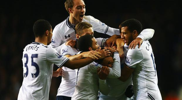 Mousa Dembele of Tottenham Hotspur is mobbed by team mates
