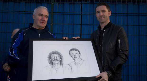 Crumlin United Secretary Martin Loughran makes a presentation of a drawing of Ronnie Keane and his dad Robbie Keane Senior on the occasion of the LA Galaxy star opening the club's new all-weather facility at Pearse Park, Crumlin on Saturday afternoon. (Striker Sports Services/ES).