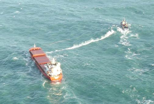 The Abuk Lion (left) under tow by the tug boat Celtic Isle off Kinsale Head