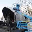 Crew set up the stage at College Green in Dublin.