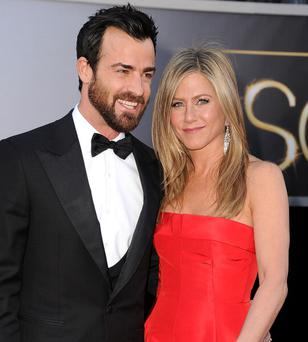 Jennifer Aniston and Justin Theroux arrives at the 85th Annual Academy Awards