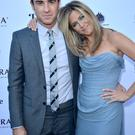 Actress/Producer Jennifer Aniston (R) (wearing Vivienne Westwood gown) and actor Justin Theroux (Photo by George Pimentel/Getty Images for The Branding Bee)