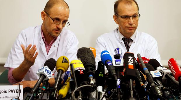 Jean-Francois Payen (L), head anaesthetician at the CHU hospital, and Emmanuel Gay (R), head of neurosurgery unit at today's news conference at the CHU hospital emergency unit in Grenoble,