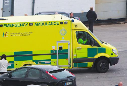 An ambulance waiting to be received at hospital