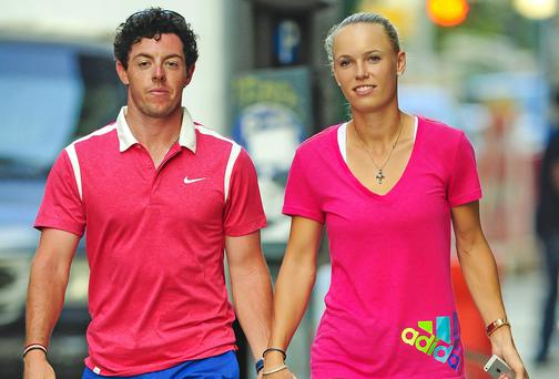 Rory McIlroy and Caroline Wozniacki hold hands while walking their dog in downtown, New York City