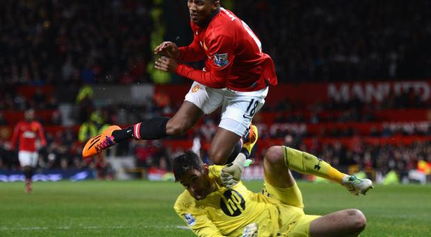 Ashley Young collides with Hugo Lloriss