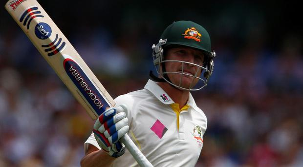 Australia's Brad Haddin celebrates his half century (50 runs) during the first day of the fifth Ashes cricket test match against England in Sydney