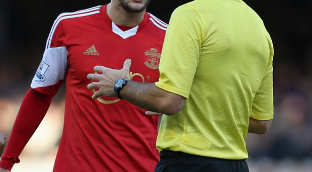 Adam Lallana of Southampton is spoken to by referee Mark Clattenburg during the Barclays Premier League match between Everton and Southampton at Goodison Park on December 29