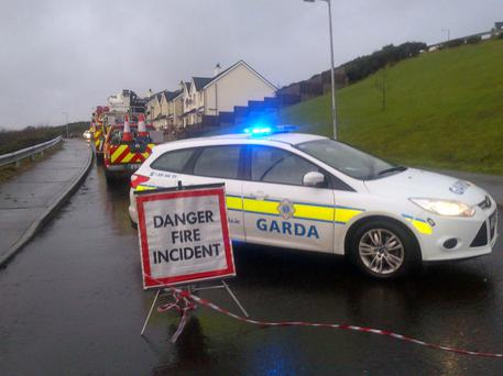 Gardai and members of the fire service at the scene of the house fire at Ceannan View, Letterkenny, Co. Donegal