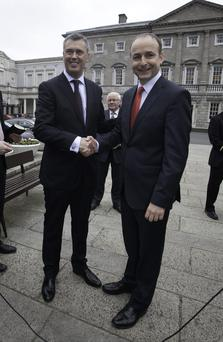 Colm Keaveney TD Fianna Fail leader Michael Martin TD during a press briefing on the plinth of Leinster House, Dublin to mark the announcement that Colm Keaveney's application to join Fianna Fail was accepted. Photo: Gareth Chaney Collins