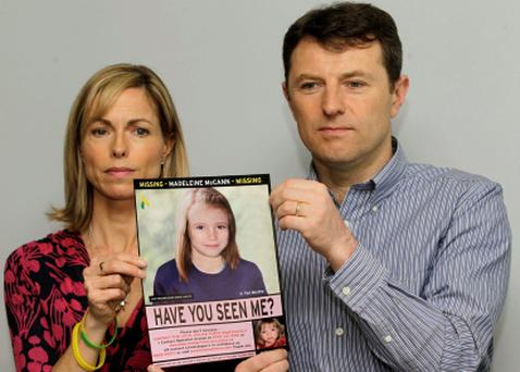 Kate McCann and Gerry McCann hold a photo of what their missing daughter Madeline may look like now