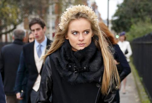 TRUE BLUE: Cressida, who shares social-climbing hair with the Middletons and was introduced to Harry by his cousin Eugenie, has fashion appeal.