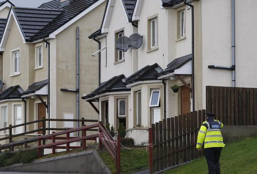 A gardai at the scene of the house fire at Ceannan View, Letterkeny, Co. Donegal yesterday. Pic: Declan Doherty