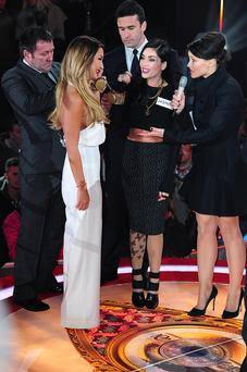 Presenter Emma Willis (right) speaks to Jasmine Waltz (centre) and Sam Faiers (left) as the are handcuffed together before entering the house at the start of Celebrity Big Brother 2014 at the Big Brother House, Elstree Studios, Hertfordshire. PRESS ASSOCIATION Photo. Picture date: Friday January 3, 2014. See PA story SHOWBIZ Brother. Photo credit should read: Ian West/PA Wire