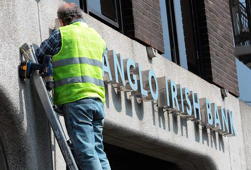 A workman removes the Anglo Irish Bank sign from outside the bank's headquarters in St Stephens Green. Picture credit: Damien Eagers
