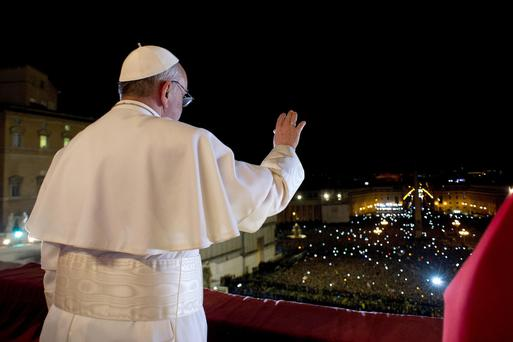 Pope Francis I appears on the central balcony of St Peter's Basilica on March 13, 2013 just after his election