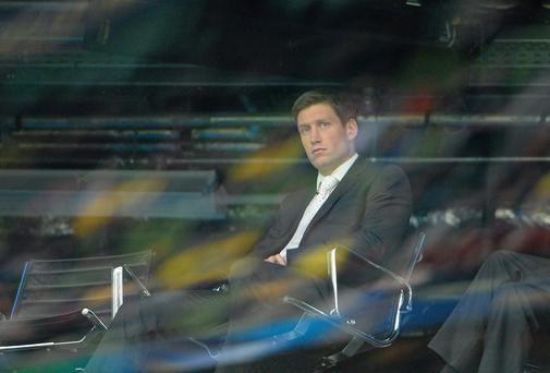 Ronan O'Gara looks on from a TV studio during the Heineken Cup final