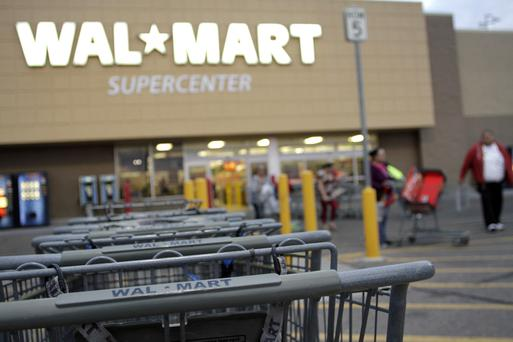 Shopping carts are seen outside a Wal-Mart Supercenter in Coolidge, Arizona in this file photo. REUTERS.