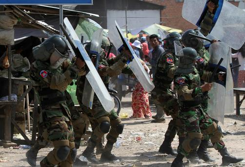 Cambodian soldiers clash with workers, on the outskirts of Phnom Penh
