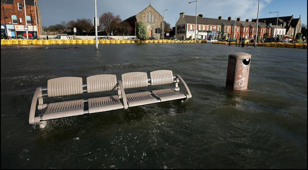The flooded car park overlooking Dublin Bay at Clontarf yesterday at High Tide. Photo: Steve Humphreys