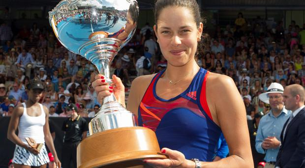 Ana Ivanovic holds the trophy after defeating Venus Williams in the singles final at the ASB Classic women's tennis tournament, at ASB Tennis Arena, in Auckland, New Zealand.