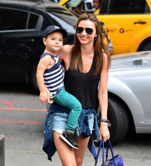 NEW YORK, NY - JULY 28: Miranda Kerr and son Flynn Bloom arrive to FAO Schwarz on July 28, 2013 in New York City. (Photo by James Devaney/WireImage)