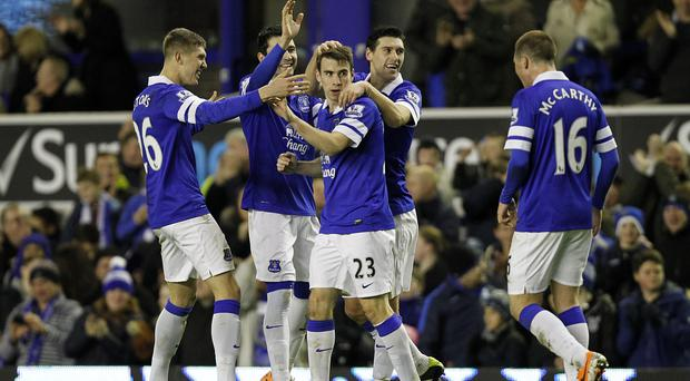 Everton's Seamus Coleman (centre) celebrates scoring his side's fourth goal of the game with teammates during the FA Cup Third Round match at Goodison Park - Stevenage will host the Toffees in the next round.