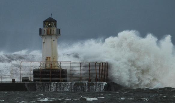 Waves brake at Ardrossan in Scotland as Britain experiences further bad weather. Danny Lawson/PA Wire