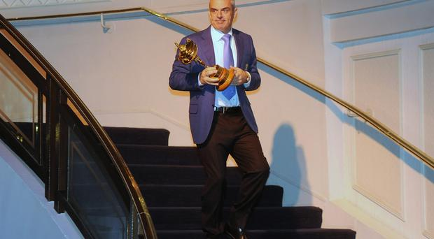 Paul McGinley walks with the Ryder Cup during the PGA Lunch at The Grosvenor House Hotel on December 20, 2013 in London