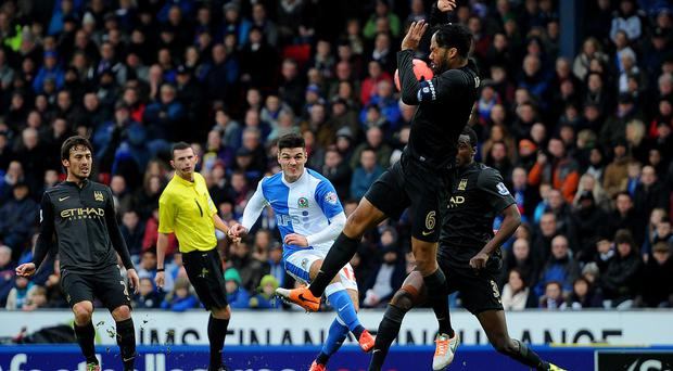 Manchester City's Joleon Lescott is hit by a shot from Ben Marshall of Blackburn Rovers at Ewood Park yesterday