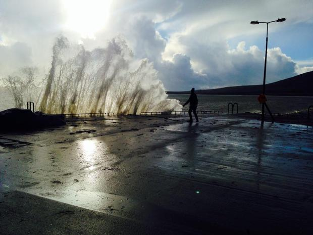 Waves wash over Ventry pier in Kerry yesterday. Photo: Emer Fitzgerald