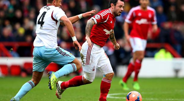 NOTTINGHAM, ENGLAND - JANUARY 05: Andy Reid is chased by George Moncur of West Ham United during the FA Cup match between Nottingham Forest and West Ham United at City Ground