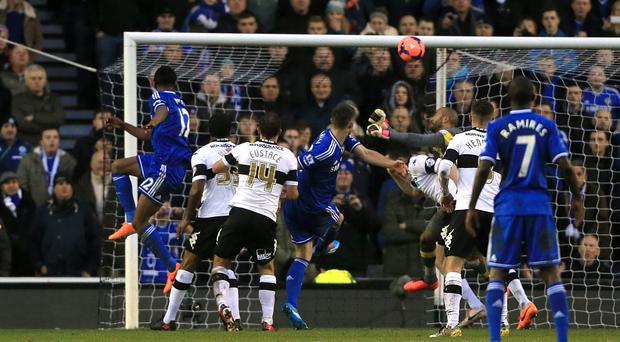 Chelsea's Jon Obi Mikel scores his side's first goal of the game during the FA Cup Third Round match at the iPro Stadium