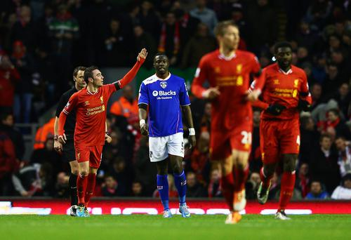 Iago Aspas of Liverpool celebrates scoring the opening goal during the Budweiser FA Cup third round match between Liverpool and Oldham Athletic at Anfield
