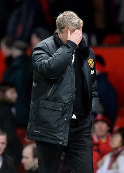 Manchester United manager David Moyes walks off the pitch dejected after the final whistle during the FA Cup Third Round match at Old Trafford