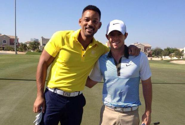 Actor Will Smith poses with golfer Rory McIlroy