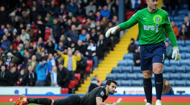 Manchester City's Alvaro Negredo shows his dejection after a missed chance with Blackburn Rovers Paul Robinson (right) during the FA Cup Third Round match at Ewood Park. Photo: Martin Rickett/PA Wire.