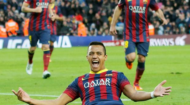 Barcelona's Alexis Sanchez celebrates his third goal during the Spanish first division soccer match against Elche. Photo: Reuters/Gustau Nacarino