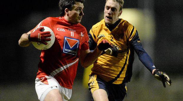 Brian White, Louth, in action against William Lowry, DCU