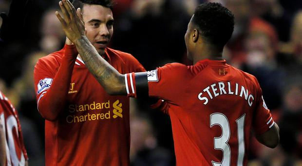 Liverpool's Iago Aspas celebrates his goal with teammate Raheem Sterling during their FA Cup third round soccer match against Oldham Athletic at Anfield. Photo: Reuters